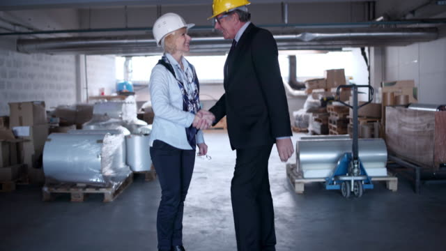 Business couple shaking hands video