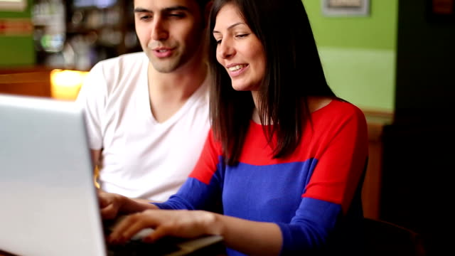 Business couple working online at a cafe video