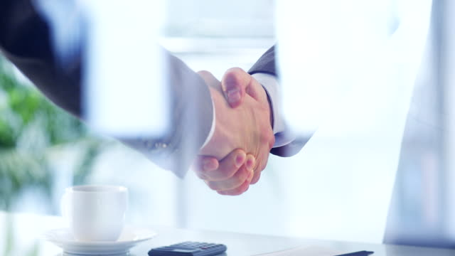 business deal - business handshake stock videos & royalty-free footage