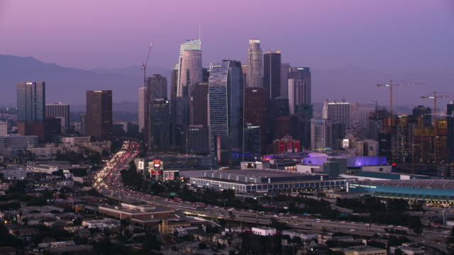 AERIAL Business district of Los Angeles at dusk