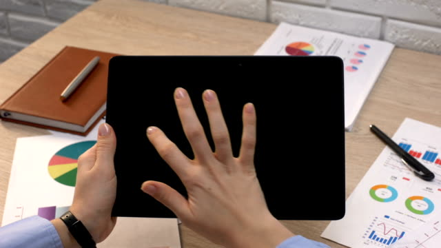 Business German application against flag on tablet in female hands, tutorial