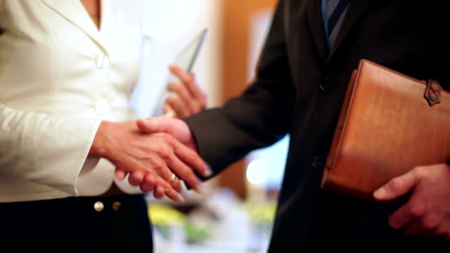 Business handshake in restaurant after lunch video