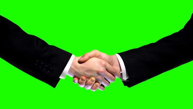 Business handshake on green screen background, partnership trust, respect sign