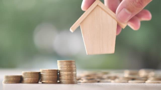 vídeos y material grabado en eventos de stock de casa de inversión de negocios, ahorrando.  cámara lenta - propiedad inmobiliaria
