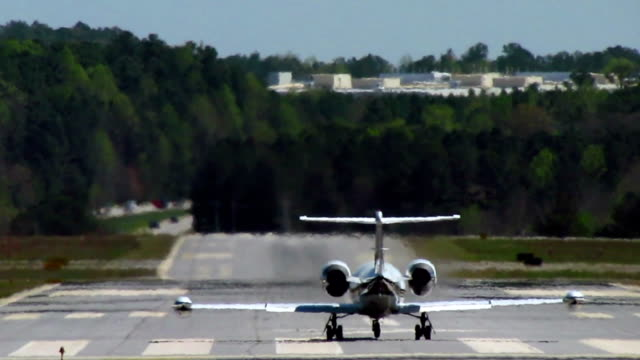 Business Jet Takeoff A Gates LearJet 35A taking off from a small, controlled airfield in the Metro Atlanta area. private airplane stock videos & royalty-free footage
