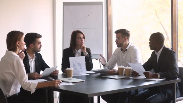 Business leader negotiate with diverse clients sit at conference table