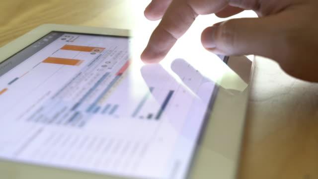 Business man analysing big data on digital tablet video