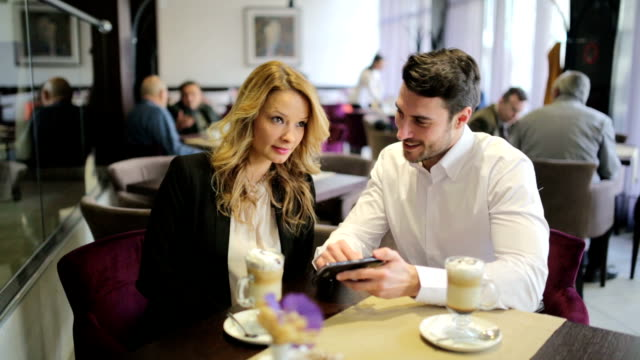 stockvideo's en b-roll-footage met business man and woman at restaurant - tafel restaurant top