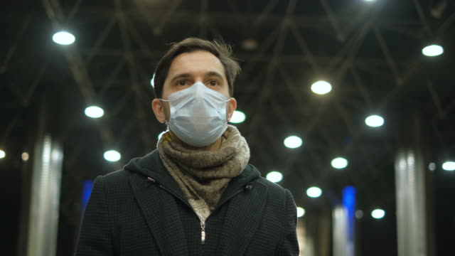 business man at airport walk. respiratory protective mask on face. coronavirus. - businessman covid mask video stock e b–roll