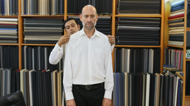 Business Man Being Measured for a Custom Tailored Suit video