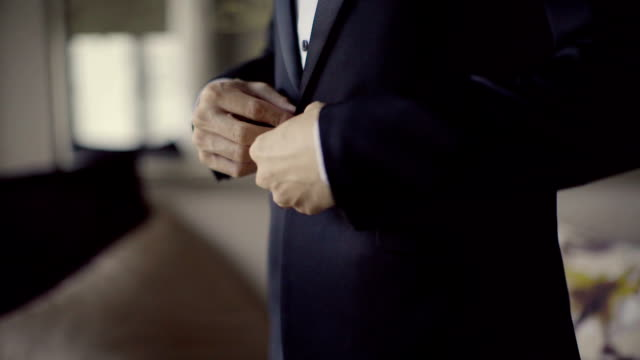 business man buttons his jacket close-up - business suit stock videos & royalty-free footage