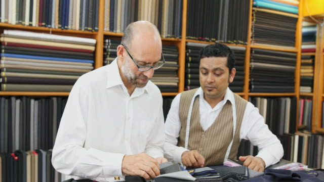 Business Man Choosing Fabric For a Custom Tailored Suit video