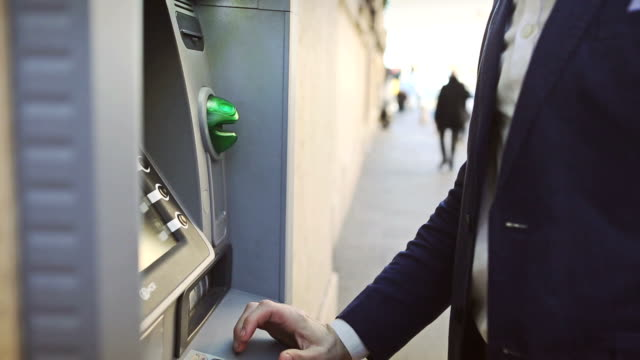 business man credit card withdrawal at bank - banks and atms stock videos & royalty-free footage