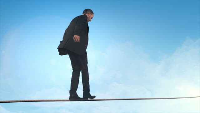 Business man doing balancing act video