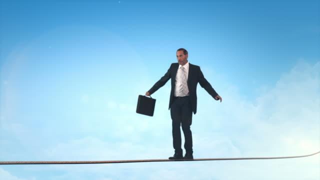 Business man doing balancing act video