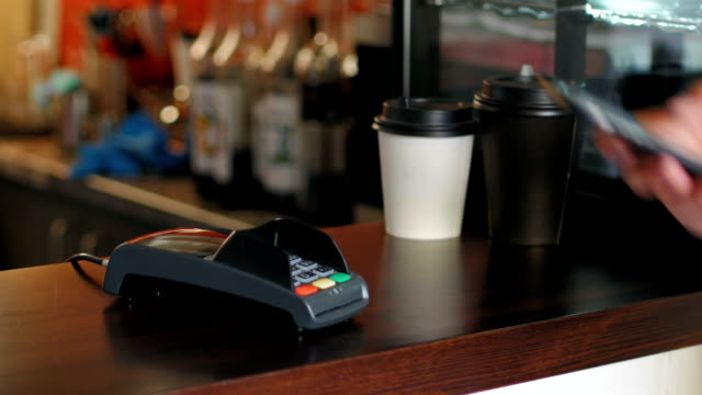 business man in jacket at cafe is paying the price by using a smartphone and terminal - contactless payment stock videos & royalty-free footage