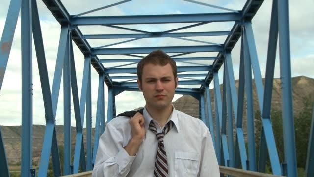 Business man on bridge video