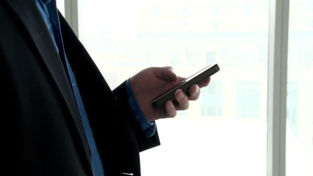 Business man on Smart phone. 360 shot. video