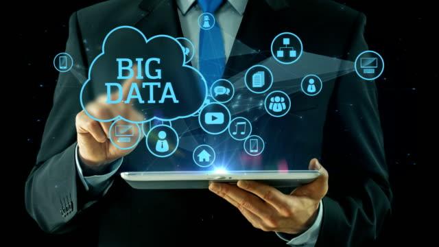 Business man pointing on big data media concept tablet pad black
