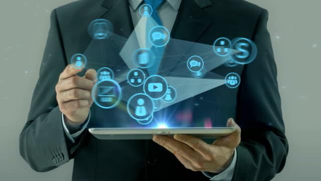business man pointing on start up concept tablet pad - продвижение трудовые отношения стоковые видео и кадры b-roll