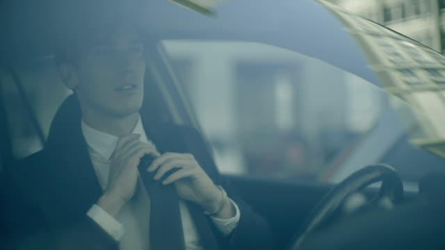 Business man preparing in a car and going to work video
