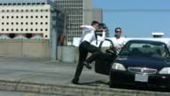 istock Business man runs through parking lot jumping over car 151883559