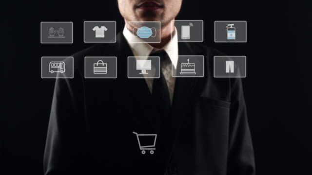 Business man selecting for virus protective icon on computer touchscreen. Healthy and medical concept.