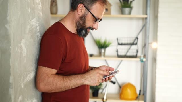 Business man text messaging on smart phone