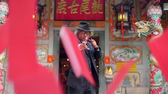 Business man throwing Chinese red envelope