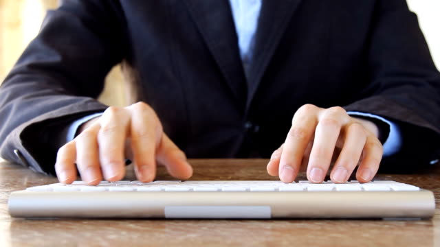business man typing on computer keyboard video