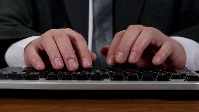 Business man typing on keyboard time-lapse video