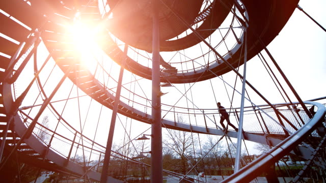 Business Man Walking Up Circular Staircase. Back lit Scenery. Climbing the Ladder of Success. video