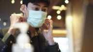 istock A Business man wearing a face mask woking at cafe 1213775669