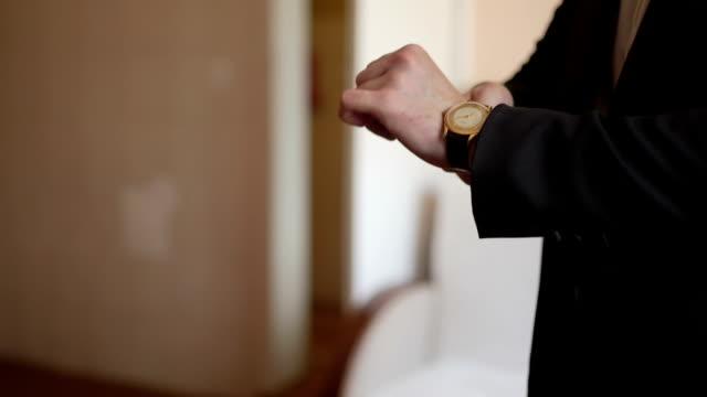 business man wearing a wristwatch video