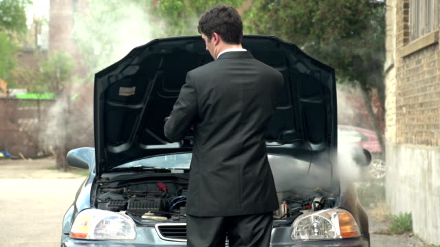 Business man with car trouble video