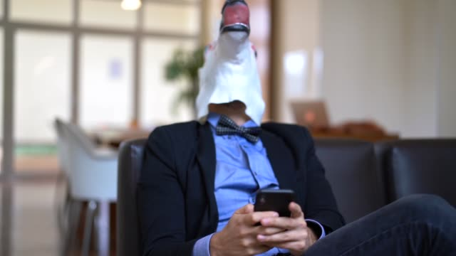 Business man with Unicorn Mask Using Mobile at Office video