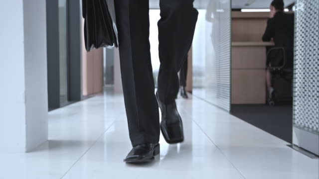 SLO MO DS Business mans shoes walking down hallway