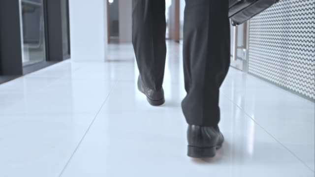 SLO MO DS Business mans shoes walking in hallway video