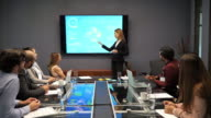 istock Business meeting - female manager presenting new financial investment concept 1164683374