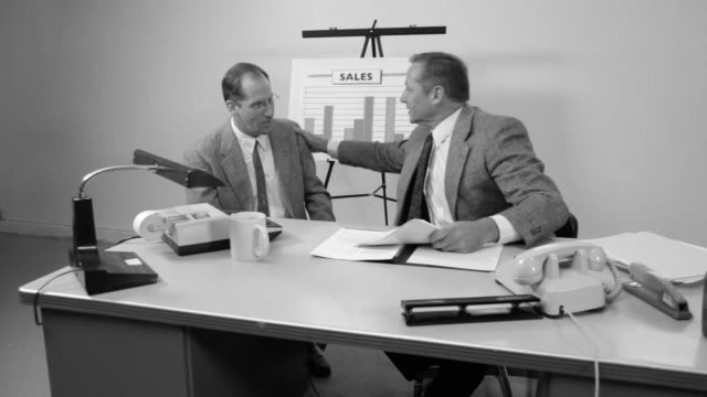 Business men meet and talk at desk video