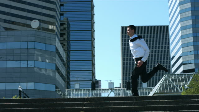 Business men running in city, slow motion video