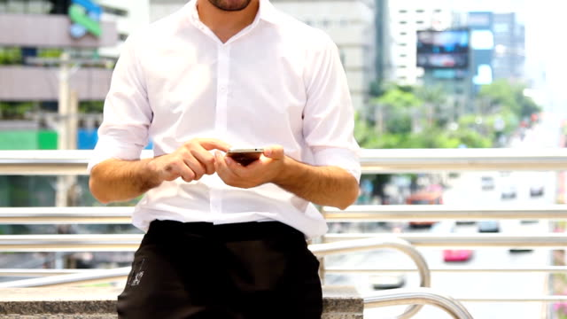 business on the go : businessman using smartphone.hd format. - owner laptop smartphone video stock e b–roll