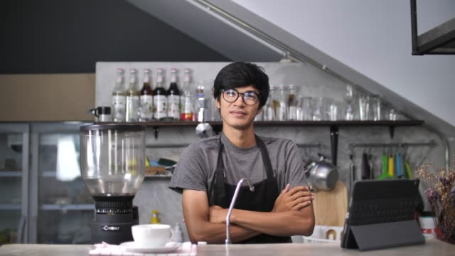 Business owner behind the counter at Cafe