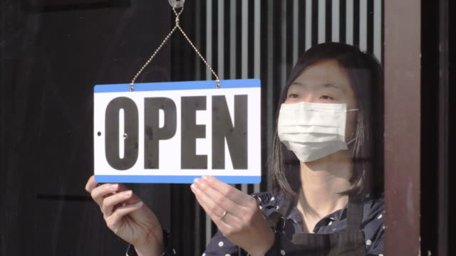 business owner opening after quarantine - essential workers stock videos & royalty-free footage