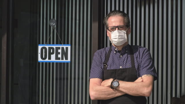 business owner opening after quarantine - open sign stock videos & royalty-free footage