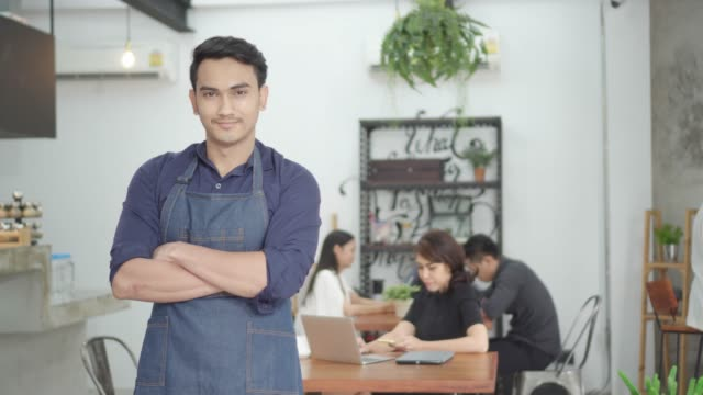 Business owner standing at a coffee shop