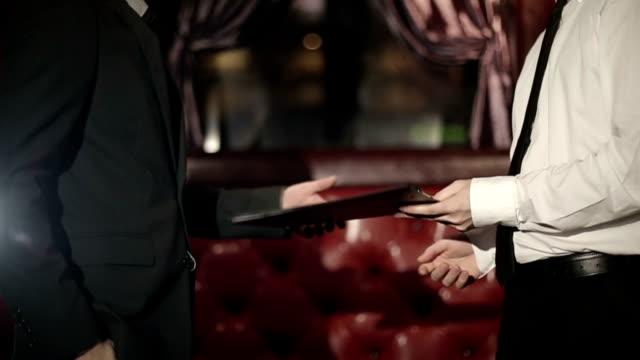Business partners. 2 men doing a handshake. video