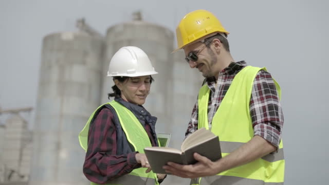 Business partners checking paperwork at construction site video