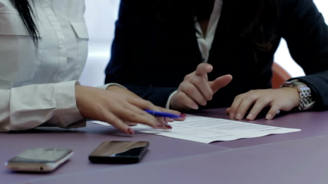 Business partners signing new contract video