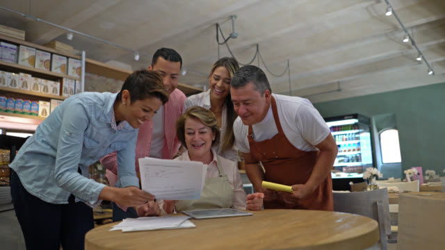 business partners, waiter and manager looking at documents of restaurant - mestiere nella ristorazione video stock e b–roll